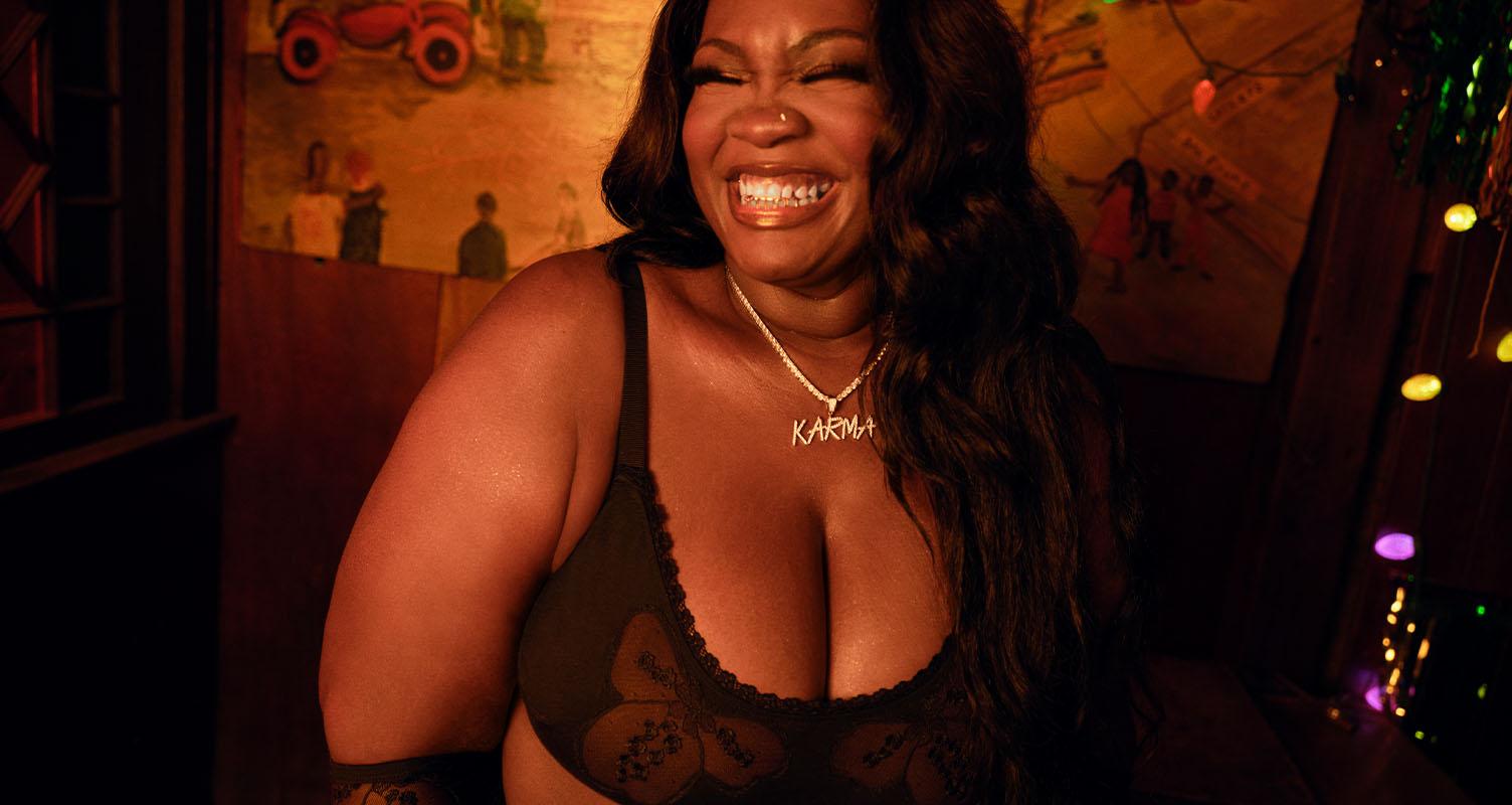 Model wearing black bra.