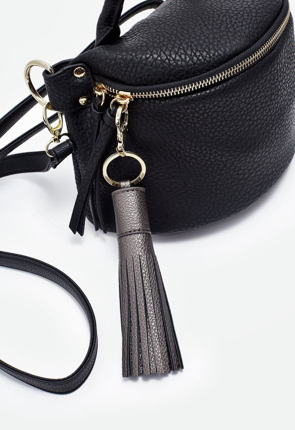 Add texture and style to your favorite bags with this large faux leather tassel key chain.