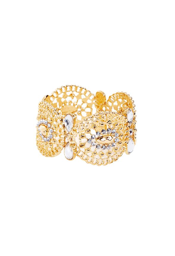 Make a statement with a mixed metal accessory. This bold cuff, with metallic and beaded accents, is both edgy and elegant. Chain link and beaded detail.