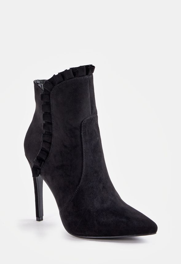 A Victorian inspired faux suede bootie with a ruffled detail, inner zip closure, and covered block heel.