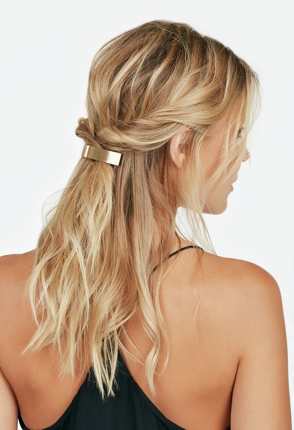 A curved gold barrette is a chic way to pull your hair back.