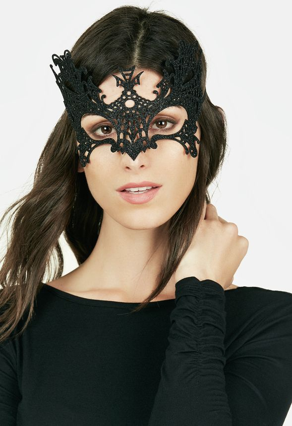 Go incognito with this intricate lace eye mask, perfect for a masquerade party.