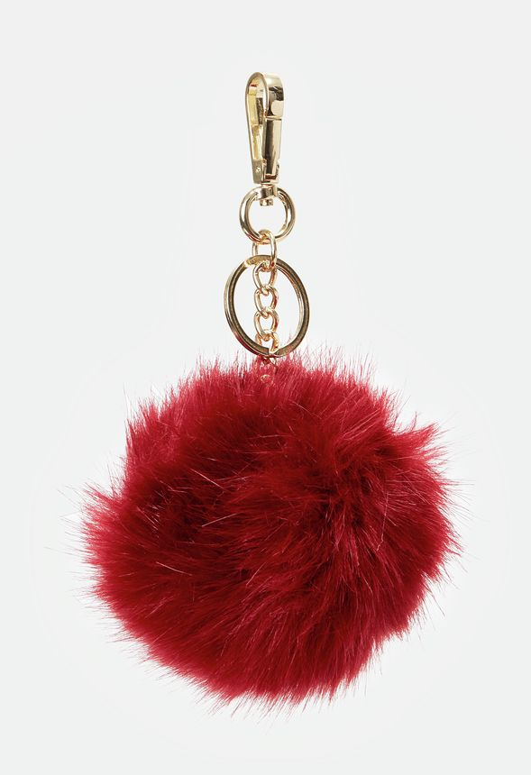 A fuzzy pom balldesigned to bring both color and fun to your favorite bags.