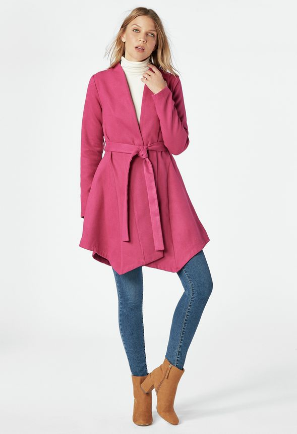 A sophisticated but fun coat featuring an asymmetric hem, tie waist, and two inseam hip pockets.