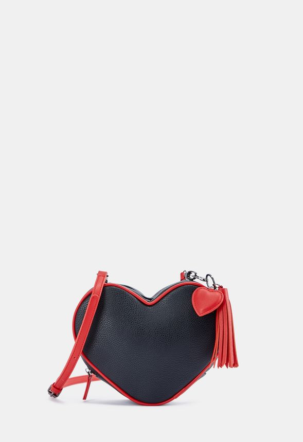 Faux leather heart shaped crossbody with contrast color shoulder strap and tassel attachment.
