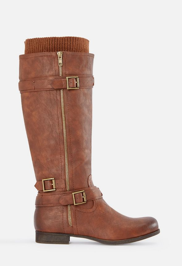 This faux leather boot features a decorative outer zip detail with buckle and strap accents. Inner zip closure, faux shearling accents.