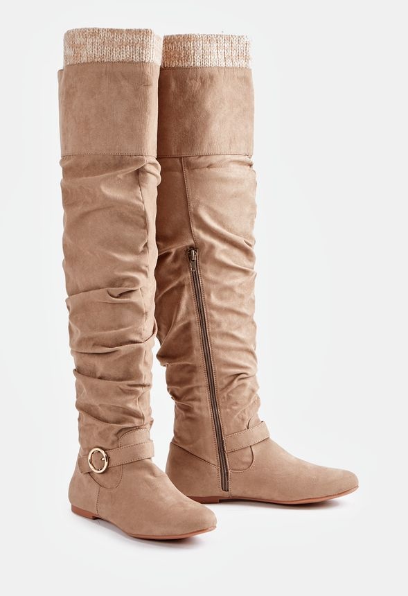 Get ready for fall with these faux suede tall boots featuring a slouchy shaft with a sweater cuff detail.