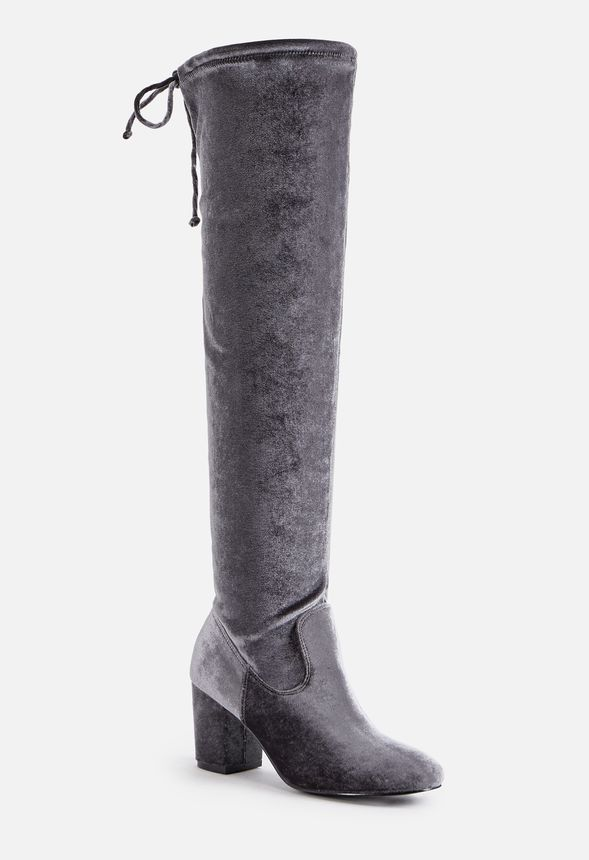 A velvet over the knee boot with a covered block heel and tie cuff accent.
