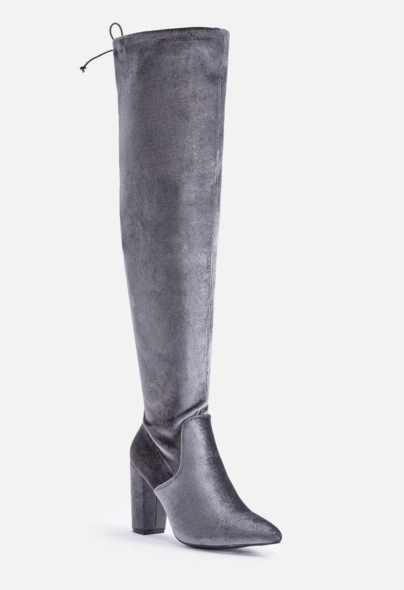 Punch up your style with these faux suede over-the-knee boots featuring a comfortable block heel you could walk miles in and a tie detail at the top for a no-slip finish.